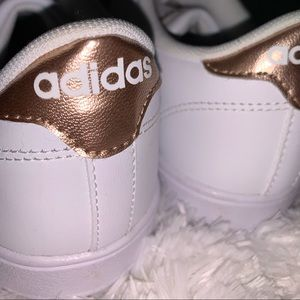 Adidas white with rose gold accent tennis shoes